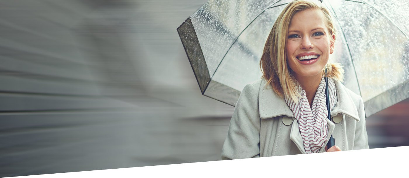 woman holding umbrella smiling